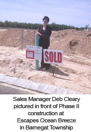 Sales Manager Deb Cleary pictured in front of Phase II construction at Escapes Ocean Breeze in Barnegat Township